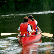 couple rowing canoe