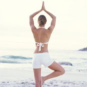 women yoga onbeach